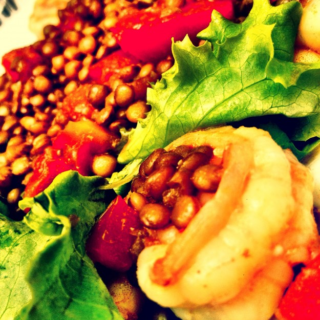 salad with sauteed shrimp curry and spiced lentils