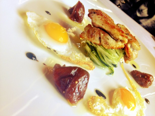 pic of Seared quail breast served with her eggs on filangè Zucchini with Cherry Tomatoes, Basil and Caramelized Fig.